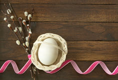 Easter egg in basket with fluffy willow Stock Image