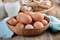 Easter egg in a basket on wodden Stock Photos