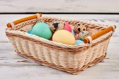 Easter egg basket on wood. Royalty Free Stock Images