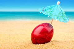 Easter egg at beach royalty free stock photo