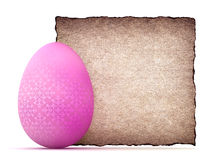 Easter egg and blank paper sheet Stock Photo