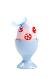 Easter egg with blue bow and printed flowers Stock Photo