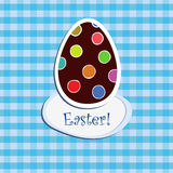 Easter egg on blue  checkered backgr. Postcard with Easter egg on blue  checkered background Royalty Free Stock Images