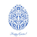 Easter egg with blue floral ornament over white Stock Photography