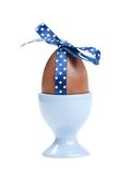 Easter egg with blue polka-dotted ribbon Stock Photography