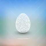 Easter egg on blurred background with place for Stock Photography