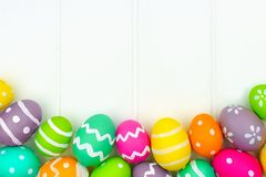 Easter egg border against a white wood background Stock Photo