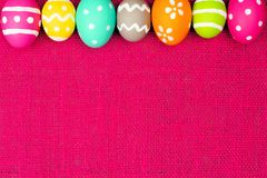 Easter egg border on pink Stock Photos