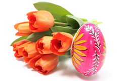 Easter egg and bouquet of orange tulips Royalty Free Stock Images