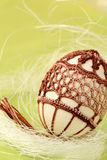 Easter egg with brown crochet decoration Stock Photos