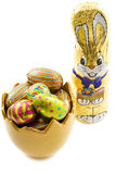 Easter egg bunnie. Bunnie with egg cup filled with chocolate eggs isolated over white Stock Image