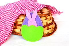 Easter egg and Bunny, basket, towel on white wooden background. Felt crafts Royalty Free Stock Images