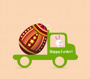 Easter egg bunny carrying a egg on the car Stock Images