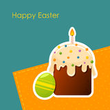 Easter egg and cake with candle Royalty Free Stock Photography
