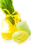 Easter egg, candle and green grass Royalty Free Stock Images
