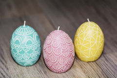 Easter egg candles Stock Photos