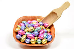 Easter egg candy. Colorful easter egg candy on the wooden bowl on white Stock Photo