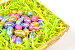 Easter egg candy. Colorful easter egg candy on the basket Stock Photography