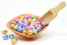 Easter egg candy. Colorful easter egg candy on the wooden bowl on white Royalty Free Stock Image