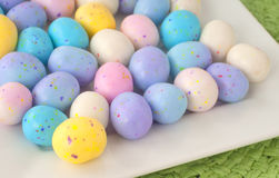 Easter Egg Candy in a Square White Dish on a Table. Closeup horizontal. Royalty Free Stock Photography