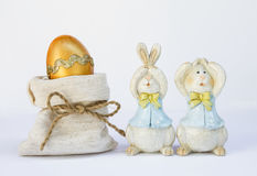 Easter egg in canvas bag with couple wooden bunny Stock Image