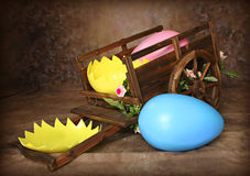 Easter Egg Cart. Western Wagon wtih Easter Eggs, One broken, would make a good digital photography prop stock photos