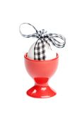 Easter egg with checked ribbon is in egg cup Stock Photo