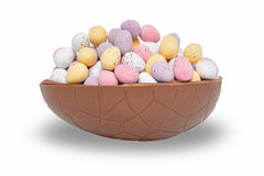 Easter egg chocolate cup. Half a chocolate Easter egg full of mini candy coated eggs,  on a white background Stock Image