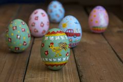 Easter egg with a cockerel on a wooden board.  Stock Photography