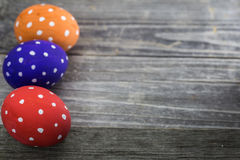 Easter egg colored polka dots. Lie on wooden background Royalty Free Stock Photography
