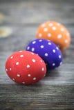 Easter egg colored polka dots. Lie on wooden background Stock Image