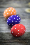 Easter egg colored polka dots. Lie on wooden background Royalty Free Stock Photos