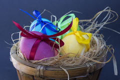 Easter egg with colored ribbons. Colorful Easter eggs with coloured ribbons Stock Photo