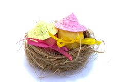 Easter egg with colored ribbons. In the straw stock photos