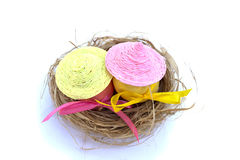 Easter egg with colored ribbons. In the straw Stock Image