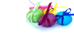 Easter egg with colored ribbons on a white background. Colorful easter eggs. Isolated on white background royalty free stock image