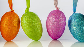 Easter egg. Coloured easter egg on reflex background stock photography