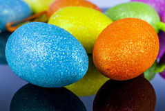 Easter egg. Coloured easter egg on reflex background stock images