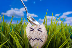 Easter Egg Concept. Broken Easter egg angry face concept Royalty Free Stock Photo