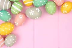 Easter egg corner border against pink wood Stock Images