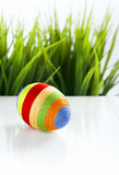 Easter egg covered with colorful woolen yarn Stock Image