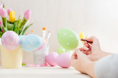 Easter egg creative painting. Stock Photo