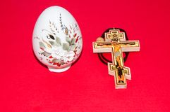 Easter egg and cross. Stock Photos
