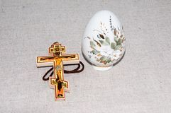 Easter egg and cross. Royalty Free Stock Image