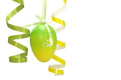 Easter egg and curly ribbons stock photography