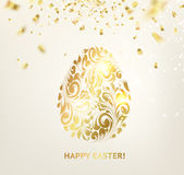 Easter egg with curves of ribbon confetti. Stock Images