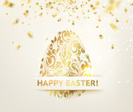 Easter egg with curves of ribbon confetti. Stock Photography