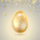 Easter egg with curves of ribbon confetti. Royalty Free Stock Image