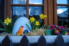 Easter egg  with daffodils by the window in Zermatt Stock Photography