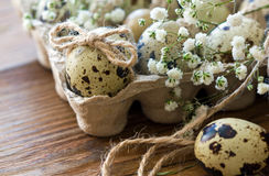 Easter egg decorated with a bow of twine. Rustic style Royalty Free Stock Photography
